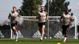 Vinicius, Bale y Kroos en un ejercicio físico esta mañana en...