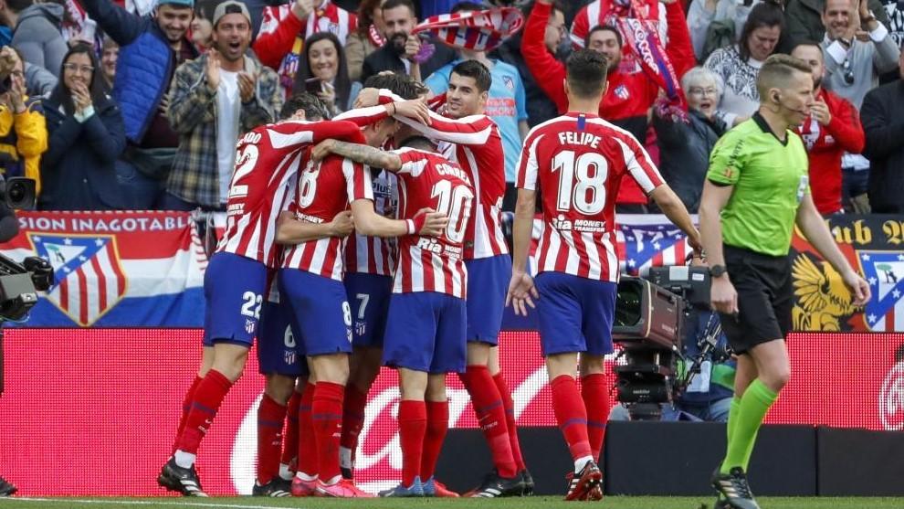Los jugadores del Atlético celebran uno de los goles marcados al...