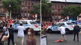 Un coche de policía embiste contra los manifestantes en Nueva York que pedían justicia