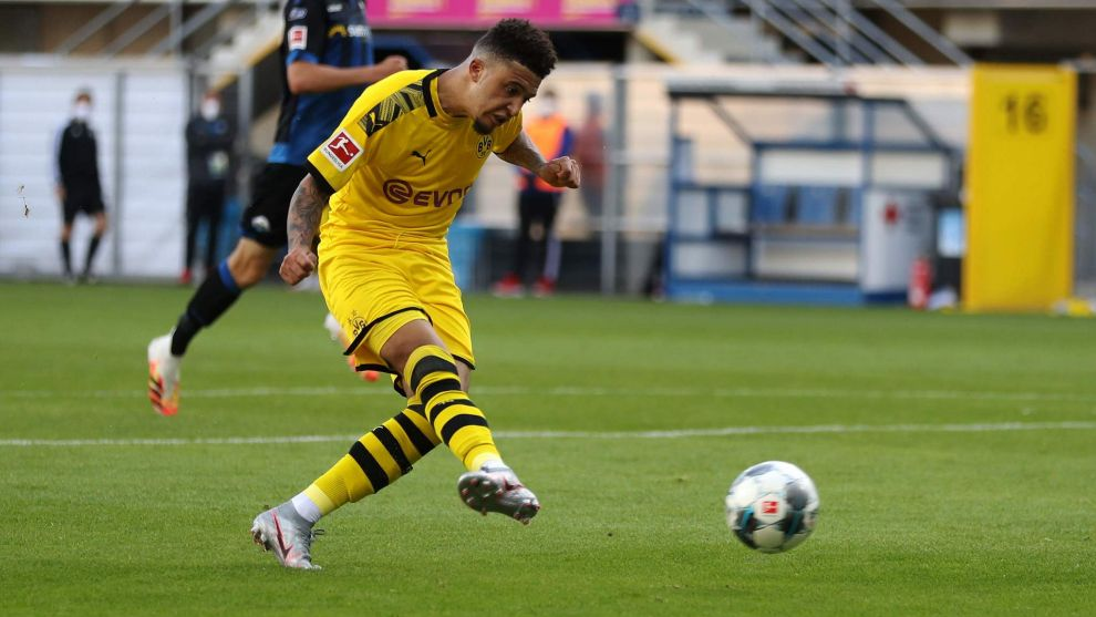 Sancho (20) shoots on goal in the