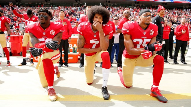 Colin Kaepernick and other San Francisco 49ers protesting in 2016
