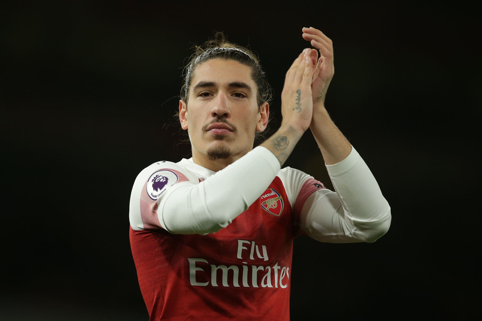 Arsenals Spanish defender Hector lt;HIT gt;Bellerin lt;/HIT gt; applauds supporters on the pitch after the English Premier League football match between Arsenal and Huddersfield Town at the Emirates Stadium in London on December 8, 2018. - Arsenal won the game 1-0. (Photo by Daniel LEAL-OLIVAS / AFP) / RESTRICTED TO EDITORIAL USE. No use with unauthorized audio, video, data, fixture lists, club/league logos or live services. Online in-match use limited to 120 images. An additional 40 images may be used in extra time. No video emulation. Social media in-match use limited to 120 images. An additional 40 images may be used in extra time. No use in betting publications, games or single club/league/player publications. /