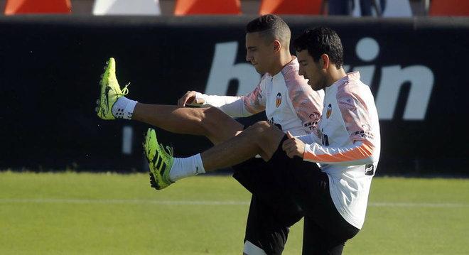 Parejo and Rodrigo training with Valencia.