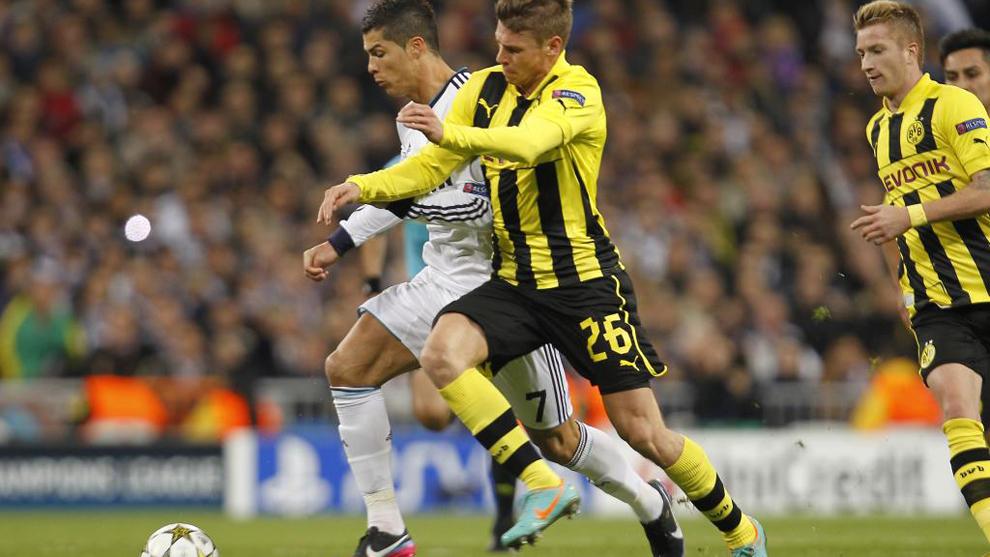 Piszczek fighting with Ronaldo for the ball.