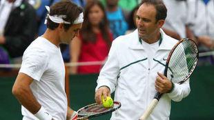 Annacone, al lado de Federer