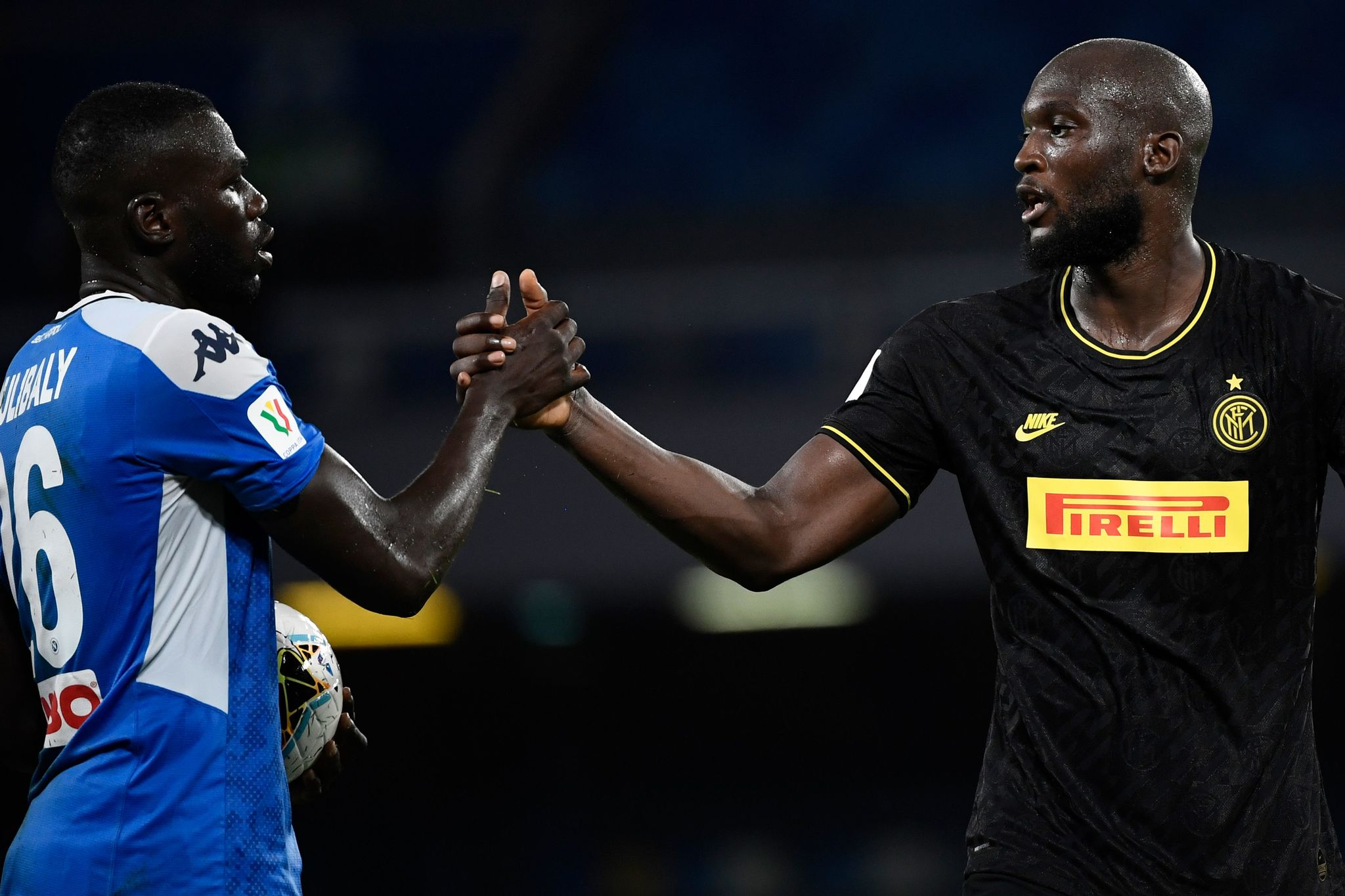 Napolis Senegalese defender Kalidou Koulibaly (L) and lt;HIT gt;Inter lt;/HIT gt; Milans Belgian forward Romelu Lukaku shake hands at the end of the Italian Cup (Coppa Italia) semi-final second leg football match Napoli vs lt;HIT gt;Inter lt;/HIT gt; Milan on June 13, 2020 at the San Paolo stadium in Naples, played behind closed doors as the country gradually eases its lockdown aimed at curbing the spread of the COVID-19 infection, caused by the novel coronavirus. (Photo by Filippo MONTEFORTE / AFP)