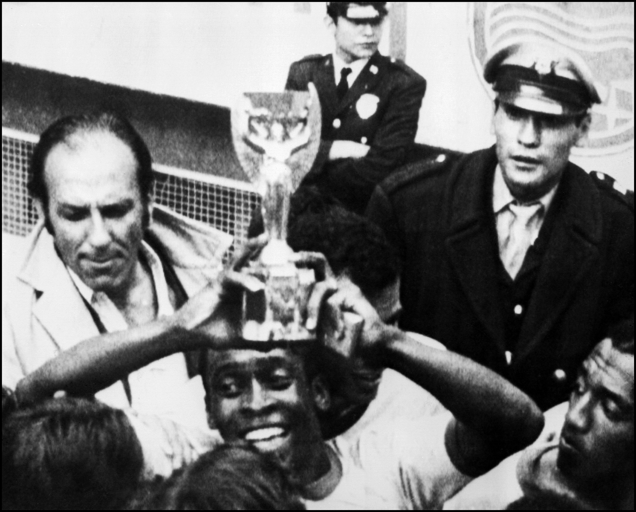 (FILES) In this file photo taken on June 21, lt;HIT gt;1970 lt;/HIT gt; Brazilian forward Pelé smiles as he holds aloft the Jules Rimet lt;HIT gt;Cup lt;/HIT gt; after lt;HIT gt;Brazil lt;/HIT gt; beat Italy 4-1 in the lt;HIT gt;World lt;/HIT gt; lt;HIT gt;Cup lt;/HIT gt; final in Mexico City. - Fifty years ago this month, modern football was born in Mexico, kicking, yelling and live in vibrant colour for a global audience. This weekend marks the anniversary of the quarterfinals as a star-studded cast played an increasingly thrilling series of knockout games which built to a dazzling final as the first colour lt;HIT gt;World lt;/HIT gt; lt;HIT gt;Cup lt;/HIT gt; ended with an unparalleled display by a technicolour team. (Photo by STF / AFP)