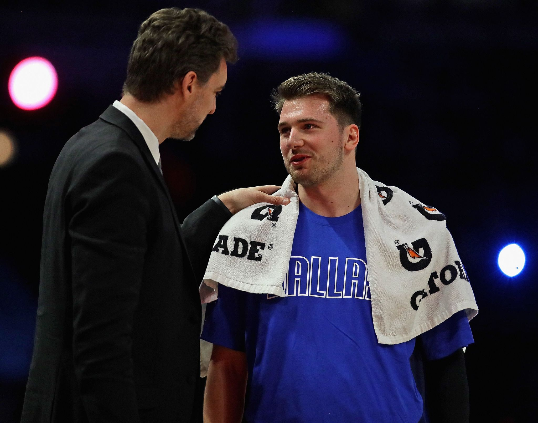 == FOR NEWSPAPERS, INTERNET, TELCOS    TELEVISION USE ONLY == CHICAGO, ILLINOIS - FEBRUARY 14: lt;HIT gt;Luka lt;/HIT gt; lt;HIT gt;Doncic lt;/HIT gt; of the World team chats with Pau Gasol during a break against the USA at the United Center on February 14, 2020 in Chicago, Illinois. NOTE TO USER: User expressly acknowledges and agrees that, by downloading and or using this photograph, User is consenting to the terms and conditions of the Getty Images License Agreement. Jonathan Daniel/Getty Images/AFP