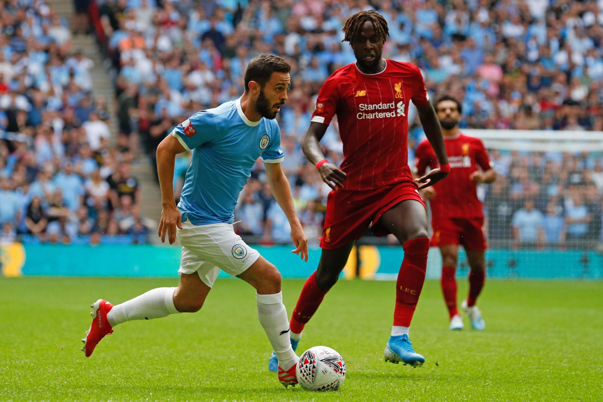 lt;HIT gt;Manchester lt;/HIT gt; lt;HIT gt;City lt;/HIT gt;s Portuguese midfielder Bernardo Silva (L) takes on lt;HIT gt;Liverpool lt;/HIT gt;s Belgian striker Divock Origi (R) during the English FA Community Shield football match between lt;HIT gt;Manchester lt;/HIT gt; lt;HIT gt;City lt;/HIT gt; and lt;HIT gt;Liverpool lt;/HIT gt; at Wembley Stadium in north London on August 4, 2019. (Photo by Adrian DENNIS / AFP) / NOT FOR MARKETING OR ADVERTISING USE / RESTRICTED TO EDITORIAL USE