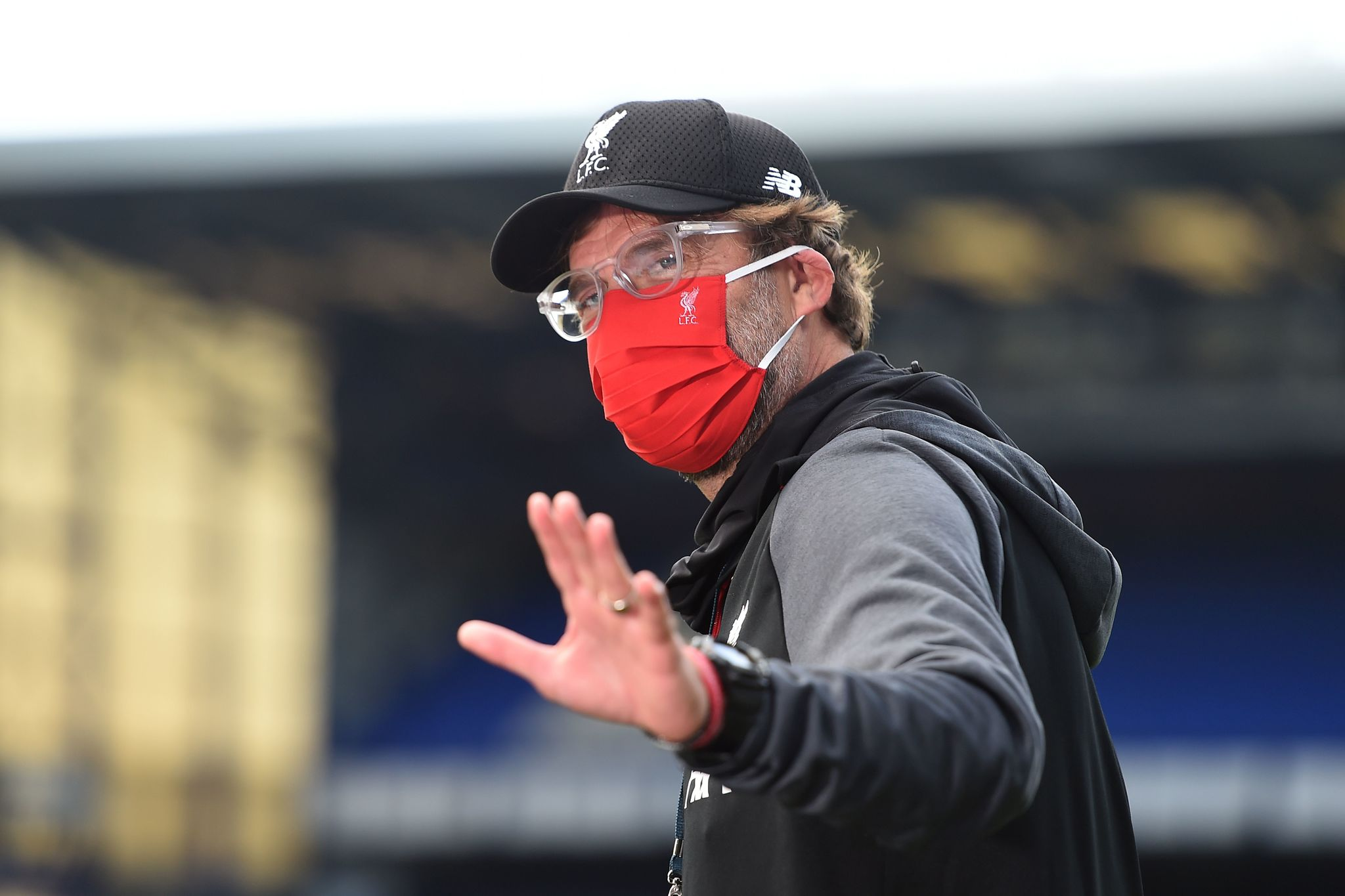 Liverpools German manager Jurgen lt;HIT gt;Klopp lt;/HIT gt; waves as he comes out for the warm up for the English Premier League football match between Everton and Liverpool at Goodison Park in Liverpool, north west England on June 21, 2020. (Photo by PETER POWELL / POOL / AFP) / RESTRICTED TO EDITORIAL USE. No use with unauthorized audio, video, data, fixture lists, club/league logos or live services. Online in-match use limited to 120 images. An additional 40 images may be used in extra time. No video emulation. Social media in-match use limited to 120 images. An additional 40 images may be used in extra time. No use in betting publications, games or single club/league/player publications. /