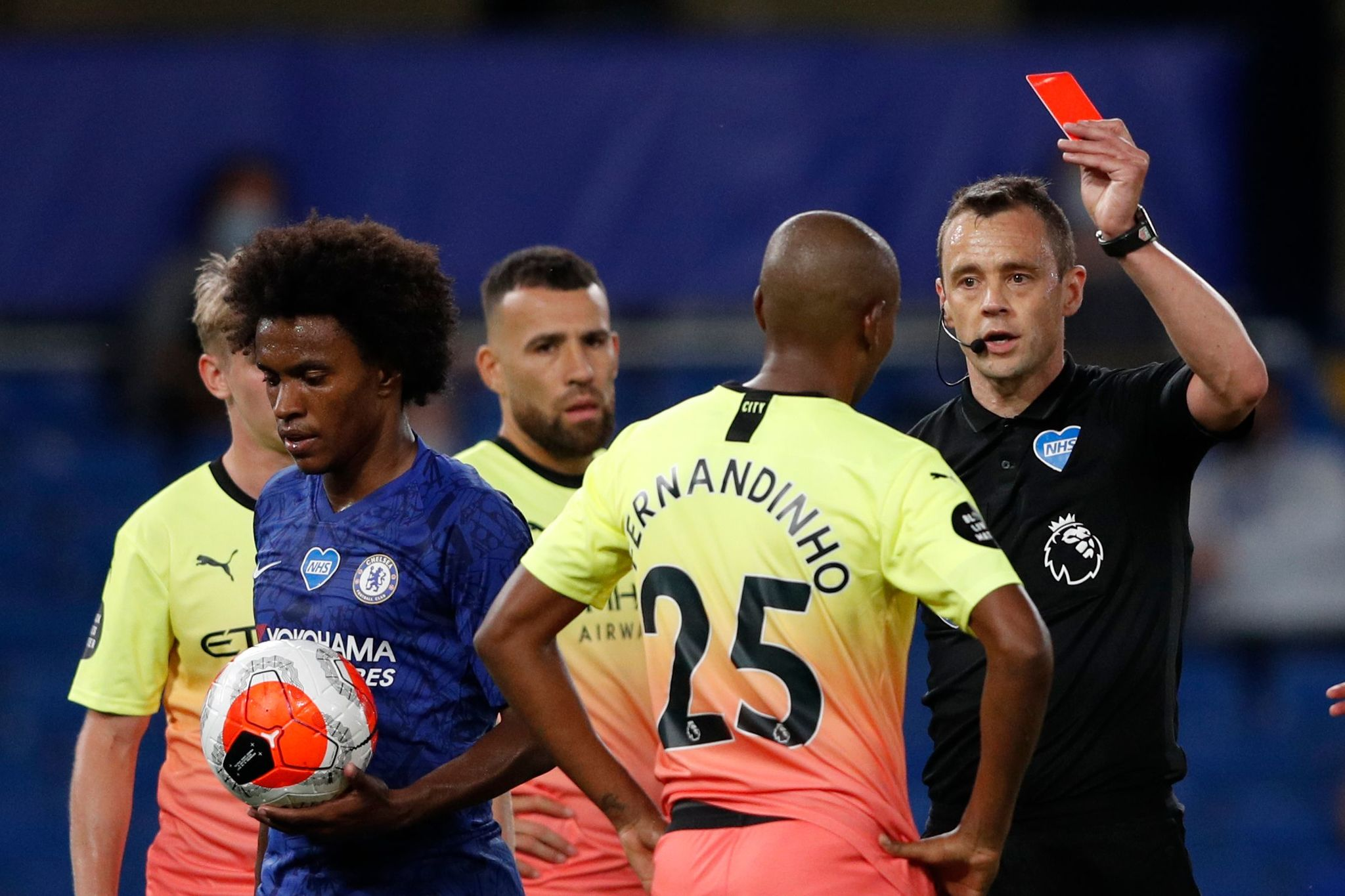 Manchester lt;HIT gt;City lt;/HIT gt;s Brazilian midfielder Fernandinho () is handed a red card during the English Premier League football match between Chelsea and Manchester lt;HIT gt;City lt;/HIT gt; at Stamford Bridge in London on June 25, 2020. (Photo by Adrian DENNIS / POOL / AFP) / RESTRICTED TO EDITORIAL USE. No use with unauthorized audio, video, data, fixture lists, club/league logos or live services. Online in-match use limited to 120 images. An additional 40 images may be used in extra time. No video emulation. Social media in-match use limited to 120 images. An additional 40 images may be used in extra time. No use in betting publications, games or single club/league/player publications. /