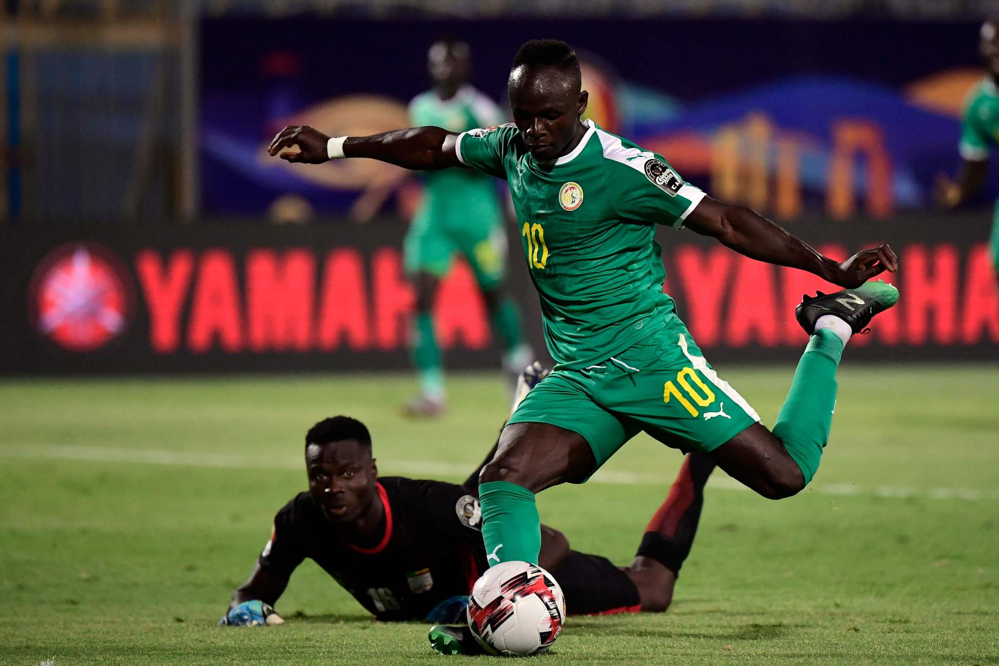 lt;HIT gt;Senegal lt;/HIT gt;s forward Sadio lt;HIT gt;Mane lt;/HIT gt; (R) scores, a goal later canceled, past Benins goalkeeper Saturnin Allagbe during the 2019 Africa Cup of Nations (CAN) quarter final football match between lt;HIT gt;Senegal lt;/HIT gt; and Benin at the 30 June stadium in Cairo on July 9, 2019. (Photo by JAVIER SORIANO / AFP)
