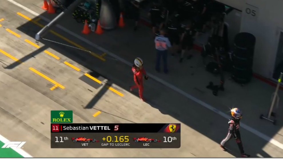 Vettel, dirigiéndose al pesaje tras caer en la Q2.