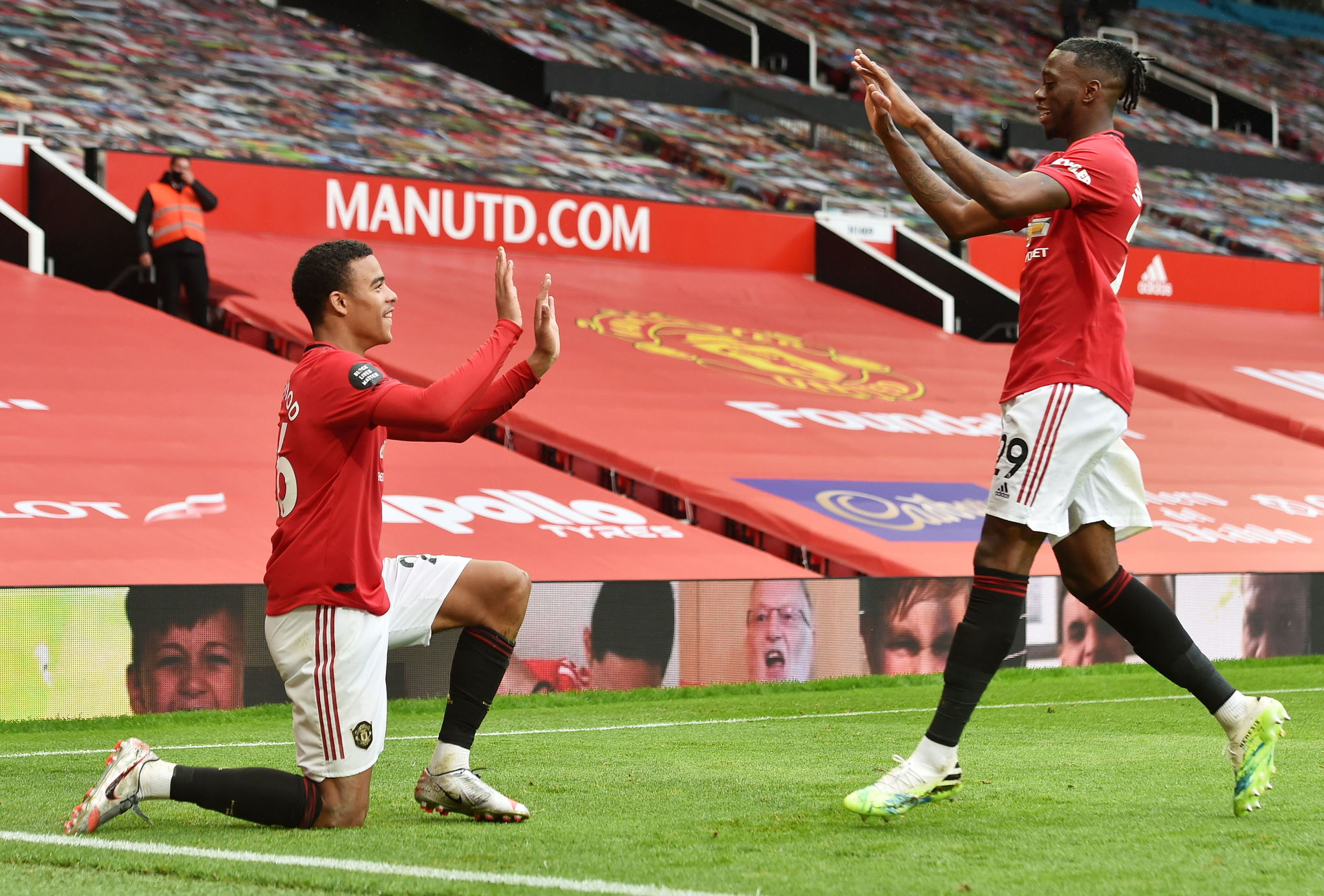 Manchester (United Kingdom), 04/07/2020.- Mason lt;HIT gt;Greenwood lt;/HIT gt; (L) of Manchester United celebrates with teammate Aaron Wan-Bissaka after scoring his teams fourth goal during the English Premier League match between Manchester United and AFC Bournemouth in Manchester, Britain, 04 July 2020. (Reino Unido) EFE/EPA/Peter Powell/NMC/Pool EDITORIAL USE ONLY. No use with unauthorized audio, video, data, fixture lists, club/league logos or live services. Online in-match use limited to 120 images, no video emulation. No use in betting, games or single club/league/player publications