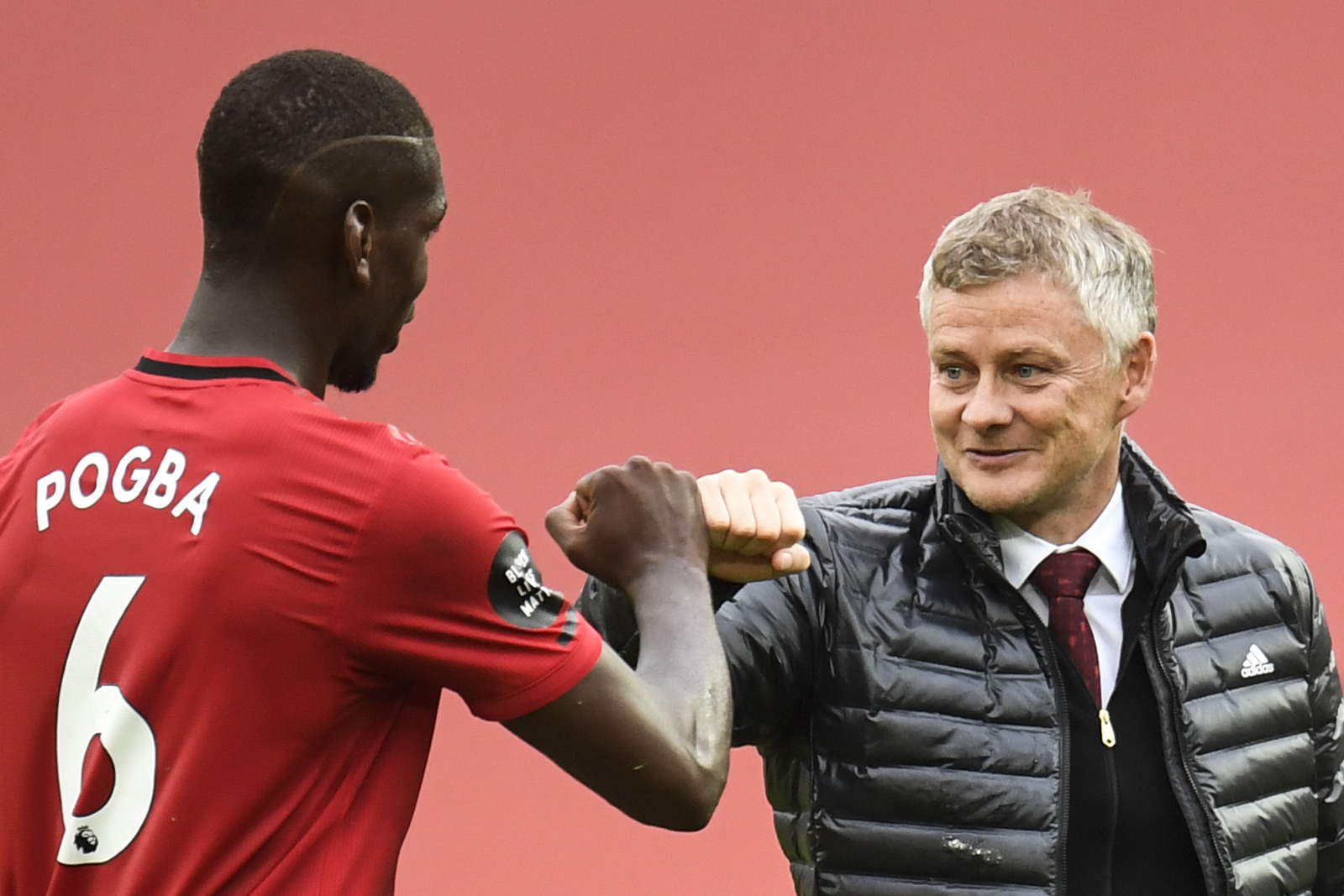 Manchester Uniteds Norwegian manager Ole Gunnar Solskjaer (R) congrtulates Manchester Uniteds French midfielder Paul lt;HIT gt;Pogba lt;/HIT gt; during the English Premier League football match between Manchester United and Bournemouth at Old Trafford in Manchester, north west England, on July 4, 2020. (Photo by PETER POWELL / POOL / AFP) / RESTRICTED TO EDITORIAL USE. No use with unauthorized audio, video, data, fixture lists, club/league logos or live services. Online in-match use limited to 120 images. An additional 40 images may be used in extra time. No video emulation. Social media in-match use limited to 120 images. An additional 40 images may be used in extra time. No use in betting publications, games or single club/league/player publications. /