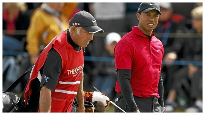 Tiger Woods, con el entonces caddie suyo Steve Williams