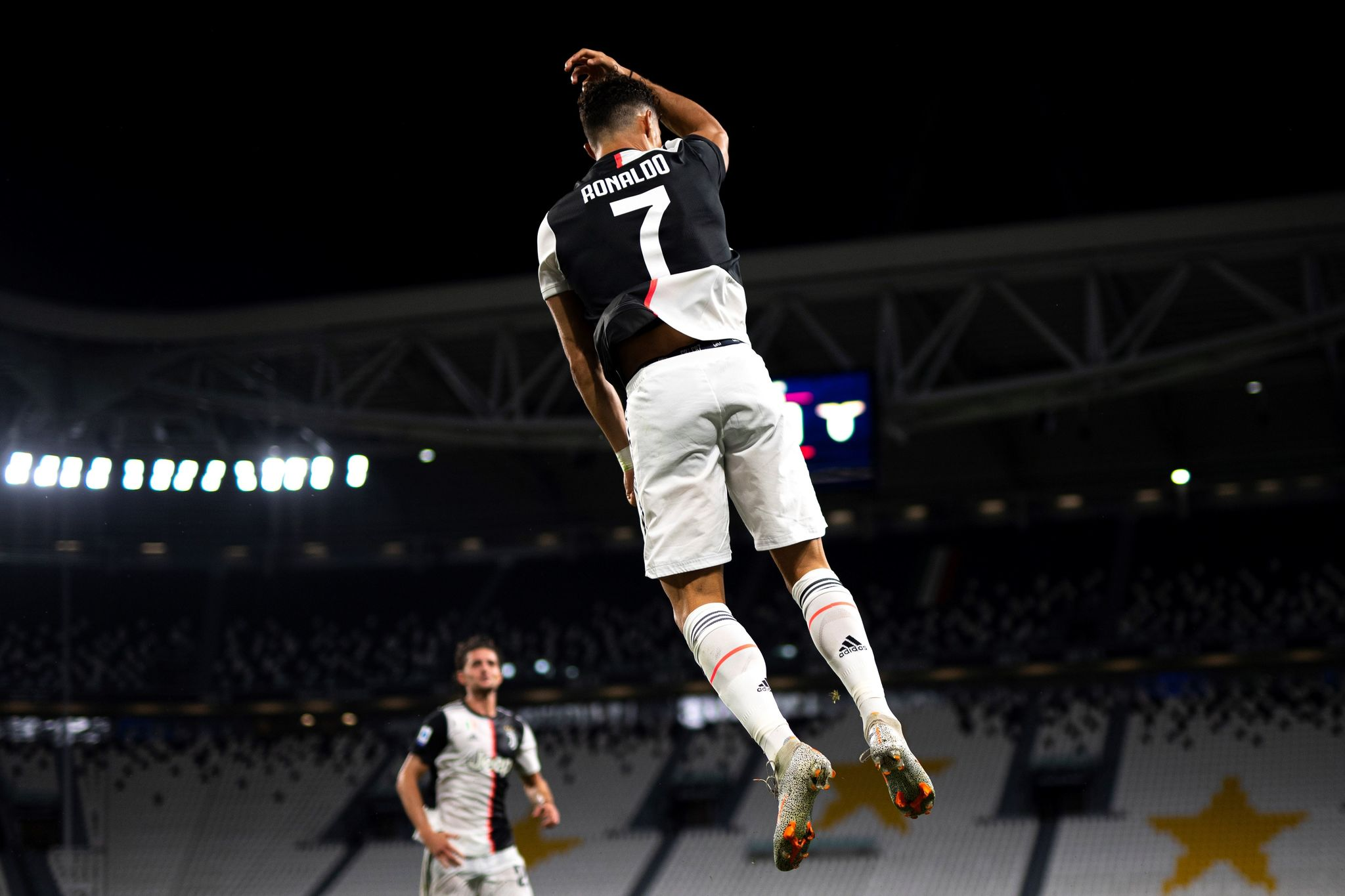 Juventus Portuguese forward lt;HIT gt;Cristiano lt;/HIT gt; lt;HIT gt;Ronaldo lt;/HIT gt; celebrates after scoring the first goal during the Italian Serie A football match between Juventus and Lazio, on July 20, 2020 at the Allianz stadium, in Turin, northern Italy. (Photo by Marco Bertorello / AFP)