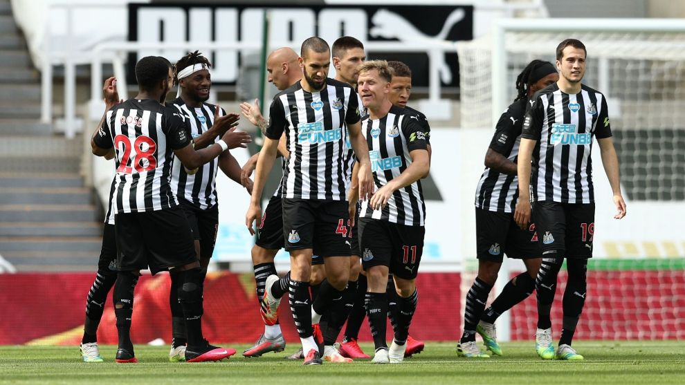 lt;HIT gt;Newcastle lt;/HIT gt; Uniteds English striker Dwight Gayle (C) celebrates with teammates after scoring a goal during the English Premier League football match between lt;HIT gt;Newcastle lt;/HIT gt; United and Liverpool at St James Park in lt;HIT gt;Newcastle lt;/HIT gt;-upon-Tyne, north east England on July 26, 2020. (Photo by Jan Kruger / POOL / AFP) / RESTRICTED TO EDITORIAL USE. No use with unauthorized audio, video, data, fixture lists, club/league logos or live services. Online in-match use limited to 120 images. An additional 40 images may be used in extra time. No video emulation. Social media in-match use limited to 120 images. An additional 40 images may be used in extra time. No use in betting publications, games or single club/league/player publications. /