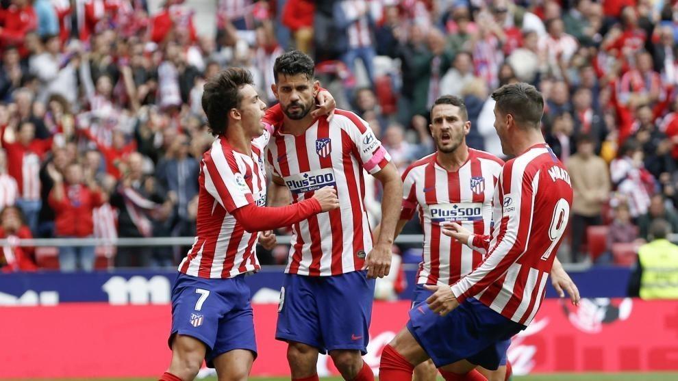 Joao Felix and Alvaro Morata celebrate with Diego Costa