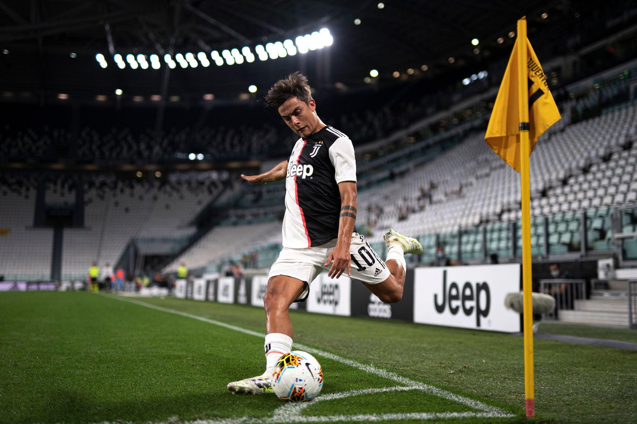 Dybala takes a corner for Juventus.