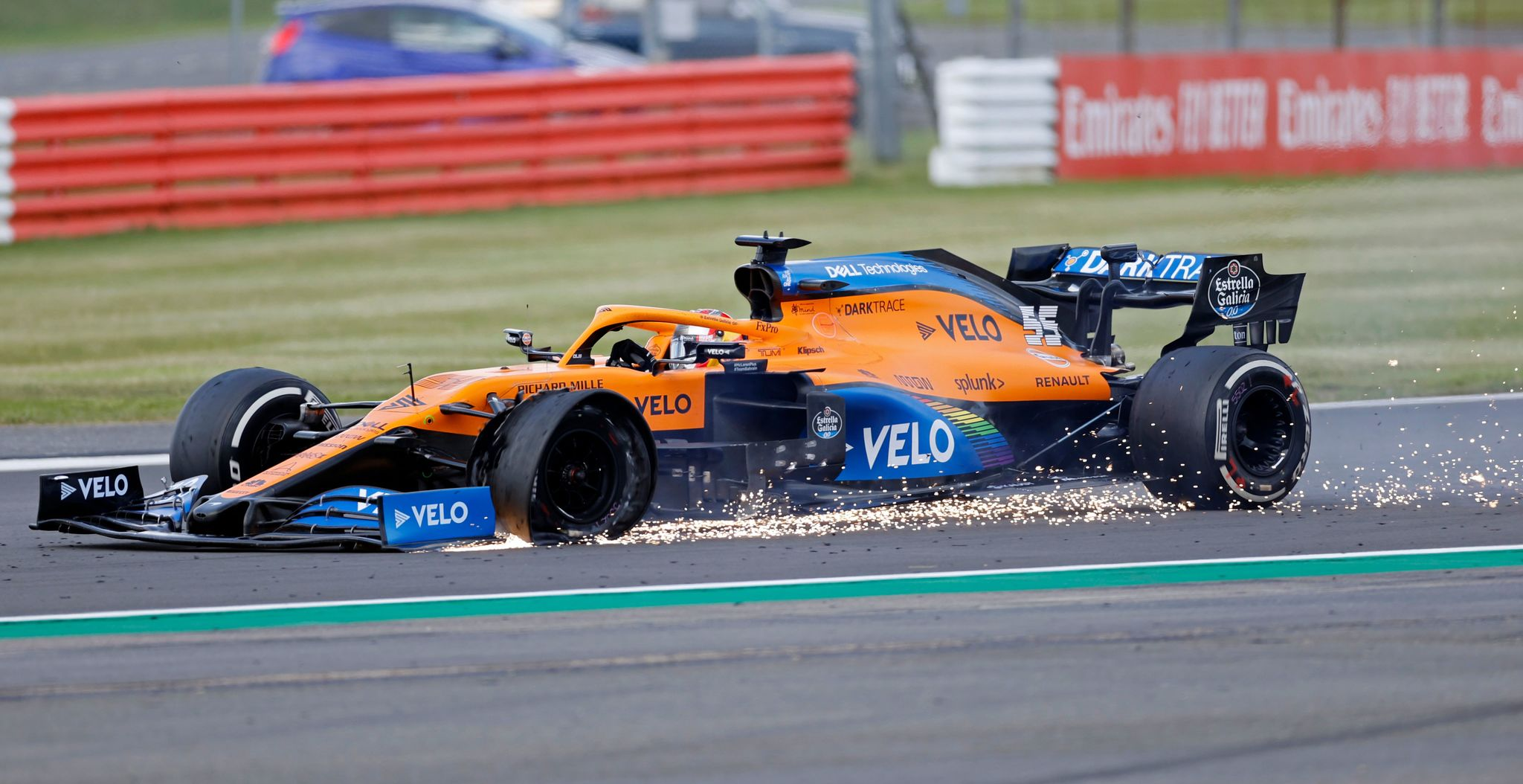 McLarens Spanish driver Carlos Sainz Jr punctures near the finish of the Formula One British Grand Prix at the lt;HIT gt;Silverstone lt;/HIT gt; motor racing circuit in lt;HIT gt;Silverstone lt;/HIT gt;, central England on August 2, 2020. (Photo by ANDREW BOYERS / POOL / AFP)