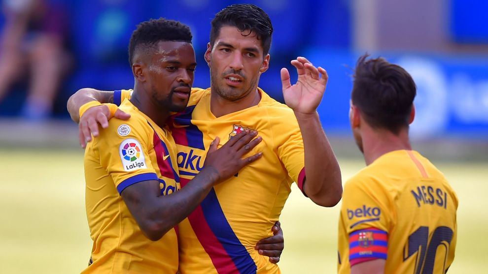 Barcelonas Portuguese defender Nelson lt;HIT gt;Semedo lt;/HIT gt; (L) celebrates his goal with teammates Barcelonas Uruguayan forward Luis Suarez (C) and Barcelonas Argentinian forward Lionel Messi during the Spanish league football match between Deportivo Alaves and FC Barcelona at the Mendizorroza stadium in Vitoria on July 19, 2020. (Photo by ANDER GILLENEA / AFP)