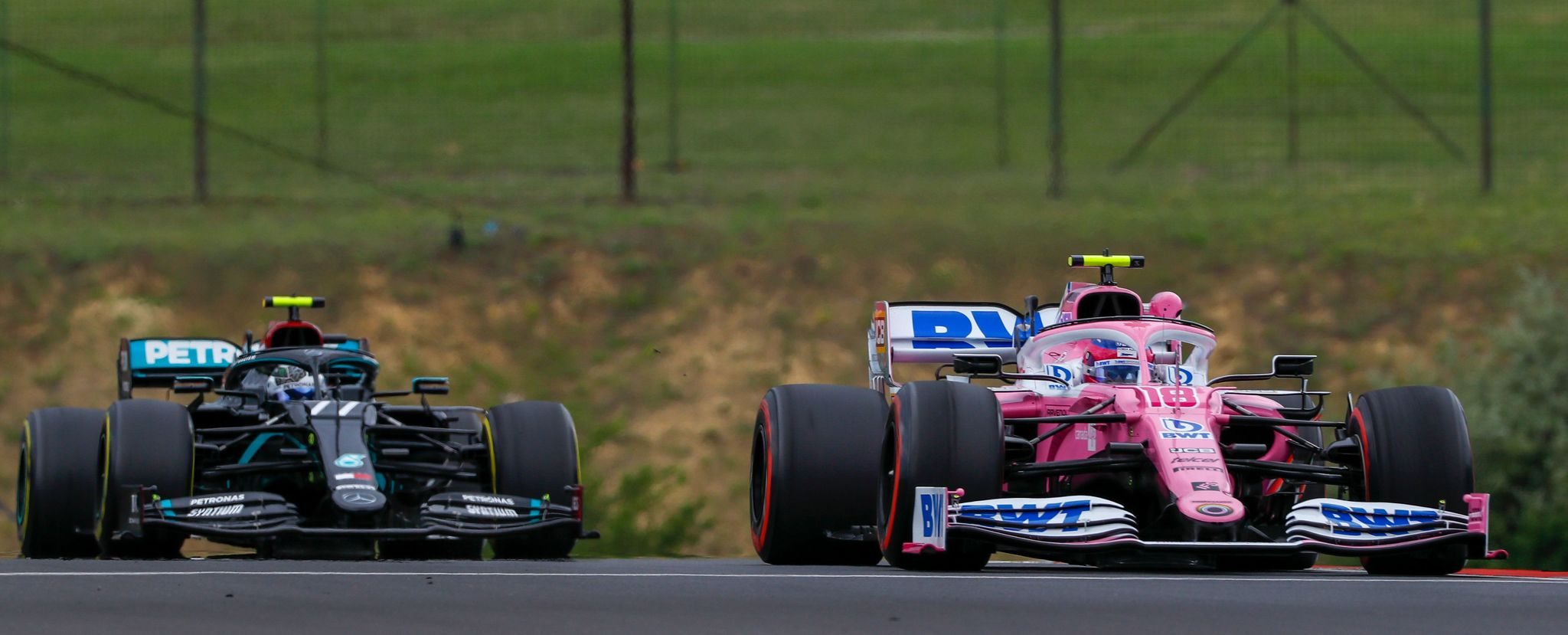 lt;HIT gt;Racing lt;/HIT gt; lt;HIT gt;Point lt;/HIT gt;s Canadian driver Lance Stroll (R) steers his car ahead of lt;HIT gt;Mercedes lt;/HIT gt; Finnish driver Valtteri Bottas during the first practice session for the Formula One Hungarian Grand Prix at the Hungaroring circuit in Mogyorod near Budapest, Hungary, on July 17, 2020. (Photo by LEONHARD FOEGER / various sources / AFP)