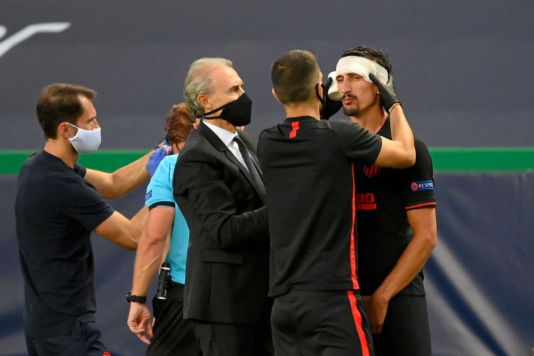 Atletico Madrids Montenegrin defender Stefan lt;HIT gt;Savic lt;/HIT gt; is attended after resulting injured during the UEFA Champions League quarter-final football match between Leipzig and Atletico Madrid at the Jose Alvalade stadium in Lisbon on August 13, 2020. (Photo by LLUIS GENE / POOL / AFP)