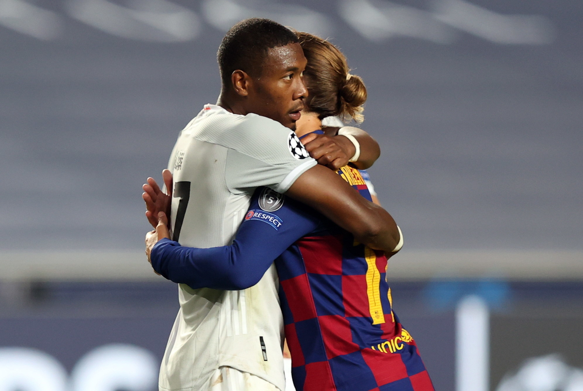 Lisbon (Portugal), 14/08/2020.- Antoine Griezmann of Barcelona (R) and David Alaba of lt;HIT gt;Bayern lt;/HIT gt; Munich hug each other at the end of the UEFA Champions League quarter final match between Barcelona and lt;HIT gt;Bayern lt;/HIT gt; Munich in Lisbon, Portugal, 14 August 2020. (Liga de Campeones, Lisboa) EFE/EPA/Rafael Marchante / POOL