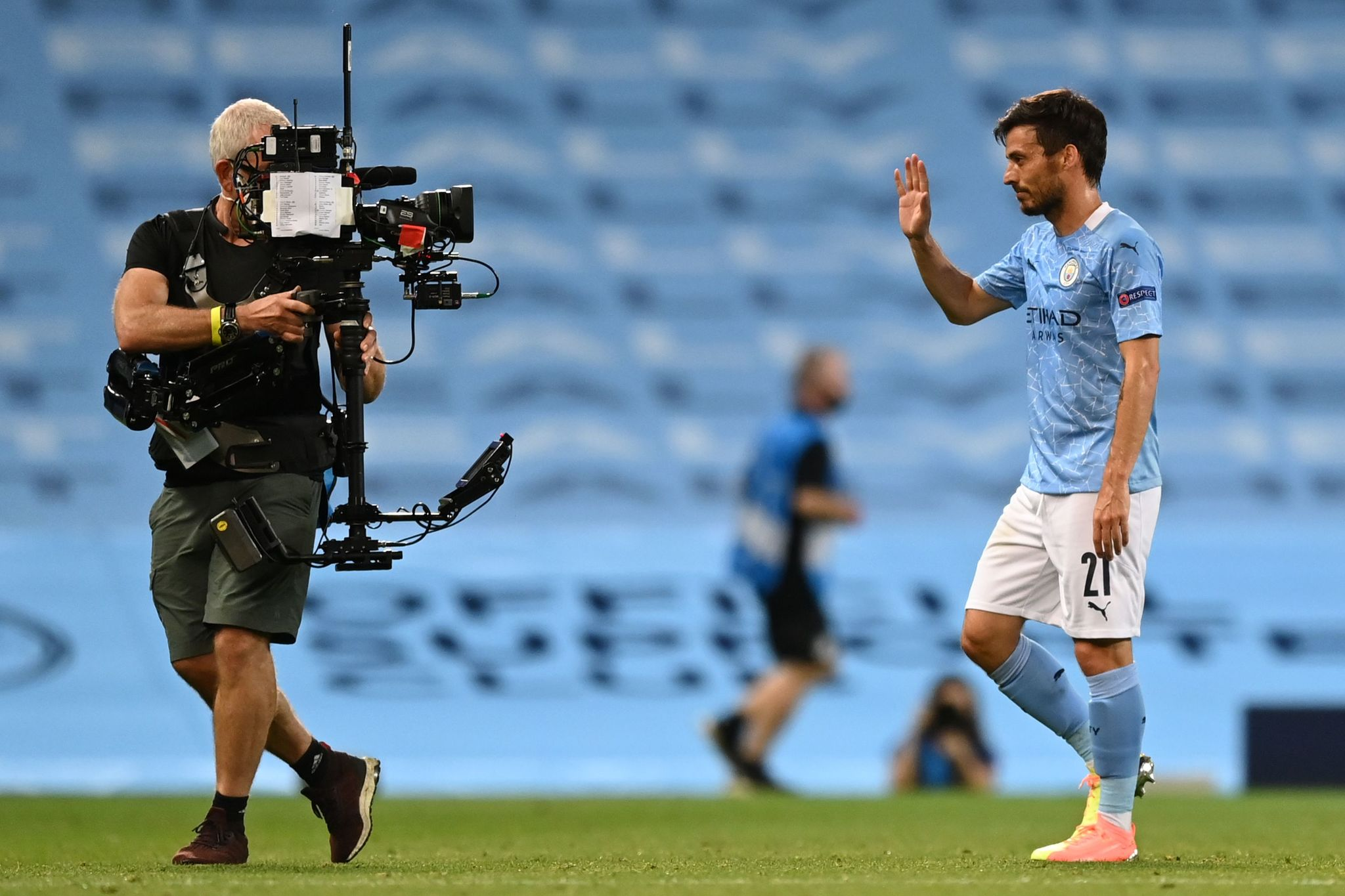 Manchester lt;HIT gt;City lt;/HIT gt;s Spanish midfielder David lt;HIT gt;Silva lt;/HIT gt; (R) waves into the lens of a television camera operator after the UEFA Champions League round of 16 second leg football match between Manchester lt;HIT gt;City lt;/HIT gt; and Real Madrid at the Etihad Stadium in Manchester, north west England on August 7, 2020. - Manchester lt;HIT gt;City lt;/HIT gt; won the match 2-1. (Photo by Shaun Botterill / POOL / AFP)