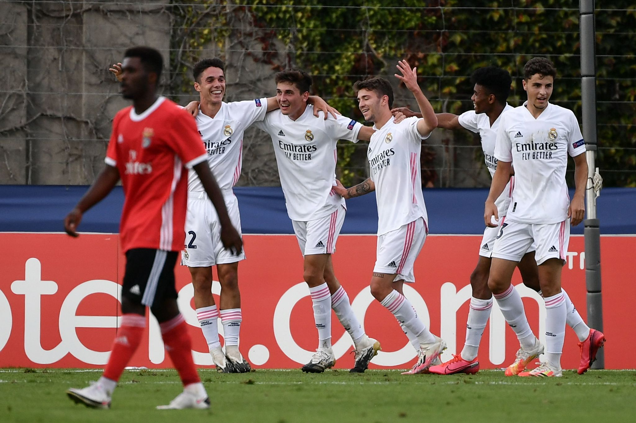 Real Madrids players celebrates as Benficas goalkeeper Leobrian Kokubo receives an own goal during the football UEFA lt;HIT gt;Youth lt;/HIT gt; League 2019/2020 final between Benfica and Real Madrid on August 25, 2020 in Nyon. (Photo by Fabrice COFFRINI / AFP)