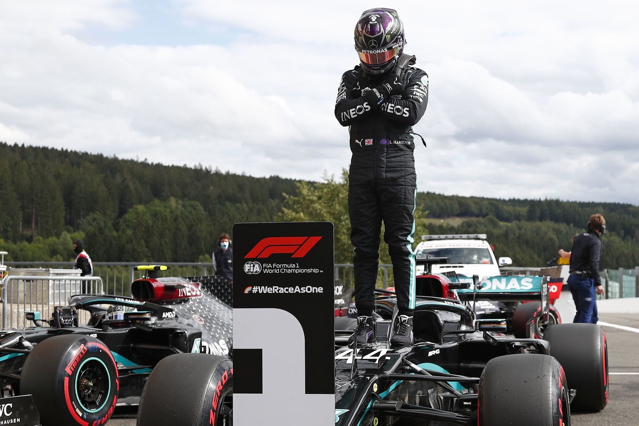 TOPSHOT - CORRECTION - Mercedes' British driver lt;HIT gt;Lewis lt;/HIT gt; lt;HIT gt;Hamilton lt;/HIT gt; gestures as he stands on his car after winning the Belgian Formula One Grand Prix at the Spa-Francorchamps circuit in Spa on August 29, 2020. (Photo by FRANCOIS LENOIR / POOL / AFP) /
