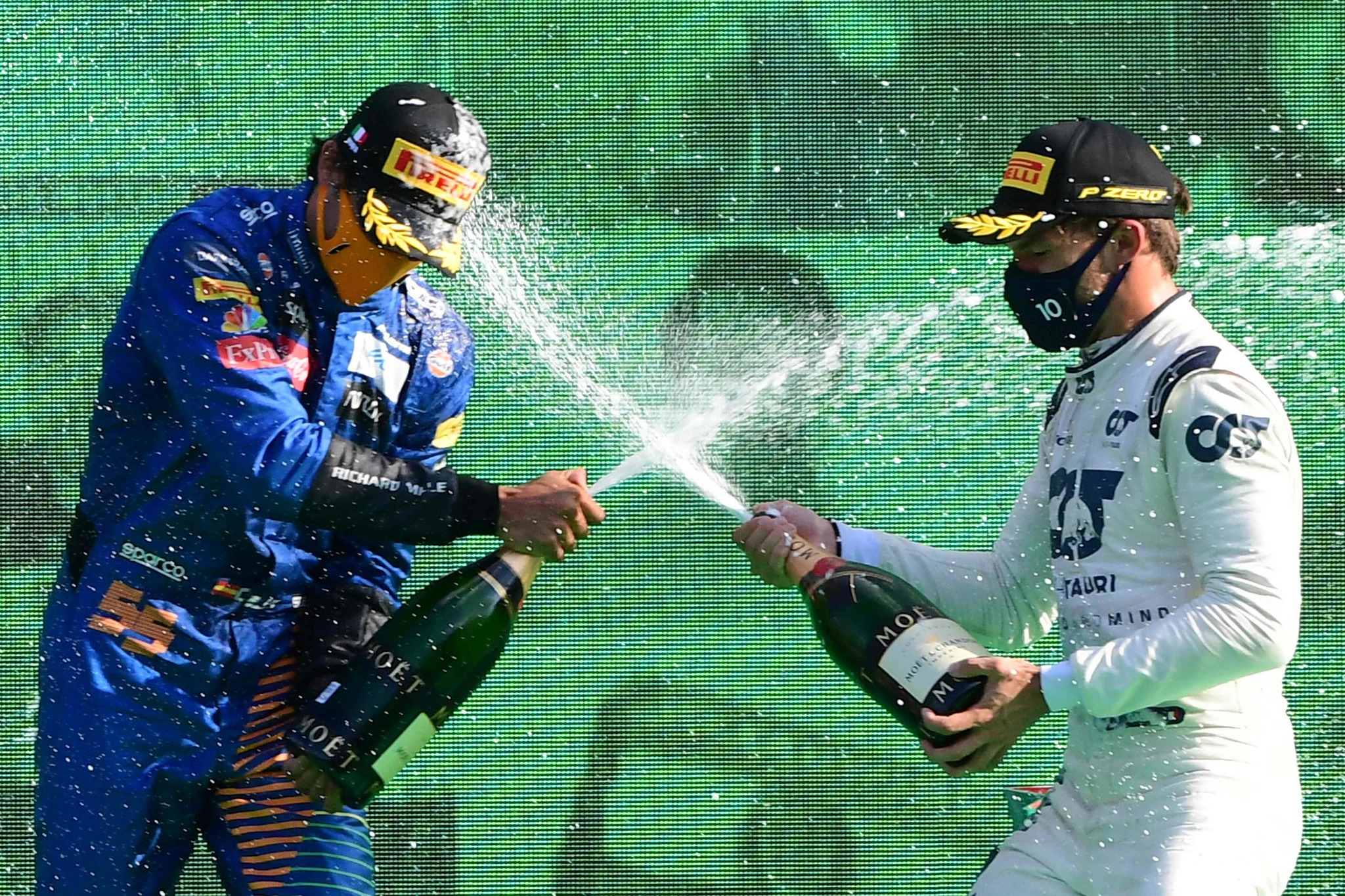 Winner AlphaTauris French driver Pierre Gasly (R) sprays champagne as he celebrates with second placed McLarens Spanish driver Carlos lt;HIT gt;Sainz lt;/HIT gt; Jr on the podium after the Italian Formula One Grand Prix at the Autodromo Nazionale circuit in Monza on September 6, 2020. (Photo by JENNIFER LORENZINI / POOL / AFP)