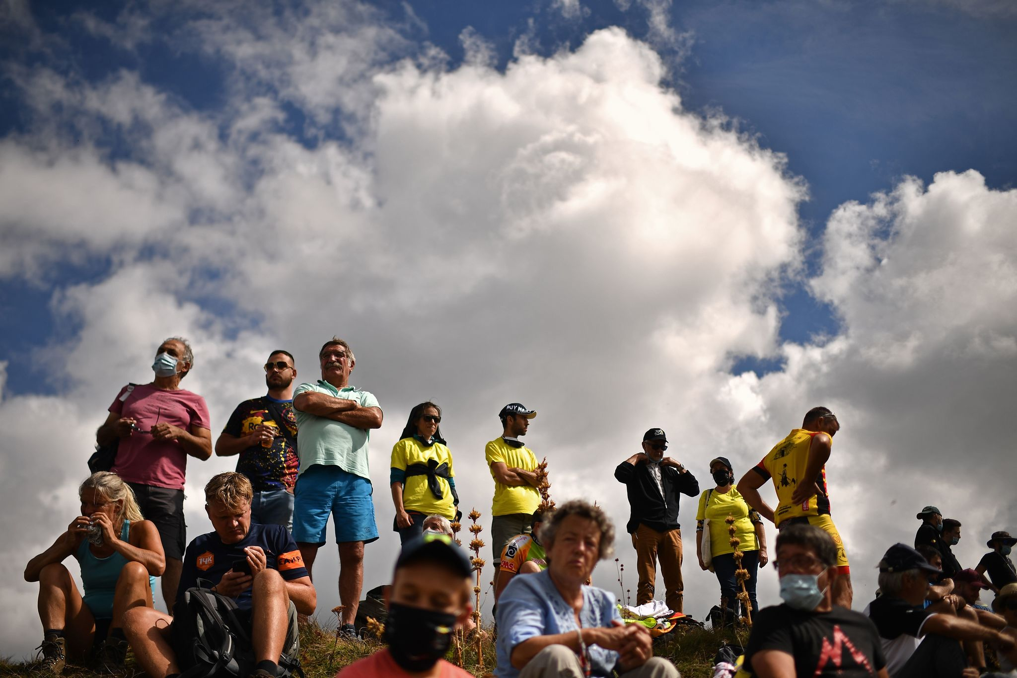 Spectators wait for the riders near the finish line in Puy Mary during the 13th stage of the 107th edition of the lt;HIT gt;Tour lt;/HIT gt; de France cycling race, 191 km between Chatel-Guyon and Puy Mary, on September 11, 2020. (Photo by ANNE-CHRISTINE POUJOULAT / POOL / AFP)