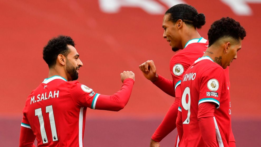 Liverpool (United Kingdom), 12/09/2020.- Liverpools Mohamed lt;HIT gt;Salah lt;/HIT gt; (L) celebrates with Virgil van Dijk (R) after scoring the 1-0 goal during the English Premier League soccer match between Liverpool and Leeds United in Liverpool, Britain, 12 September 2020. (Reino Unido) EFE/EPA/Paul Ellis / POOL EDITORIAL USE ONLY. No use with unauthorized audio, video, data, fixture lists, club/league logos or live services. Online in-match use limited to 120 images, no video emulation. No use in betting, games or single club/league/player publications