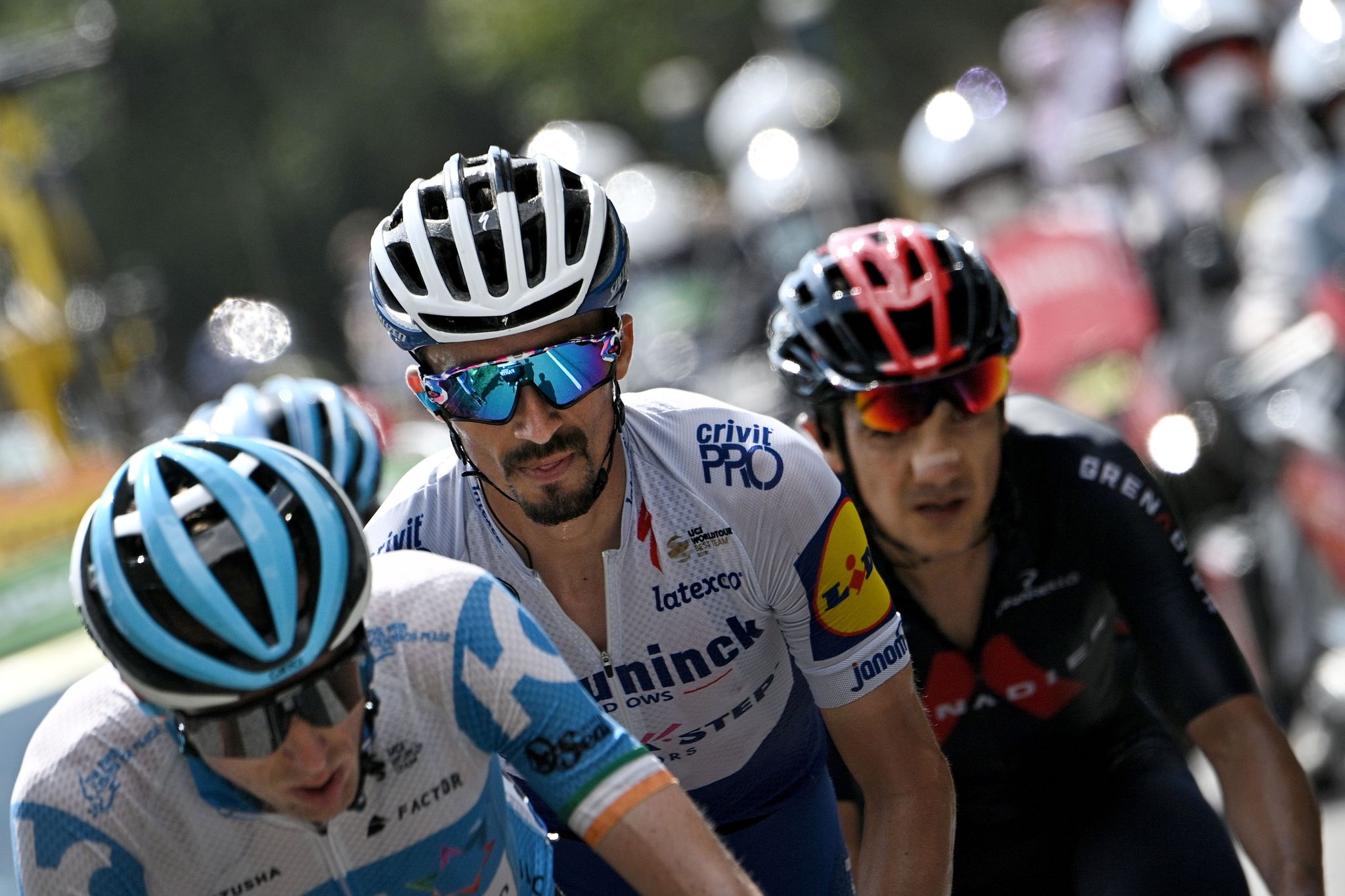 Escapees (From L) Team Israel Academy rider Ireland's Daniel Martin, Team Deceuninck rider France's Julian Alaphilippe and Team Ineos rider Ecuador's Richard Carapaz ride during the 17th stage of the 107th edition of the lt;HIT gt;Tour lt;/HIT gt; de France cycling race, 170 km between Grenoble and Meribel, on September 16, 2020. (Photo by Anne-Christine POUJOULAT / AFP)