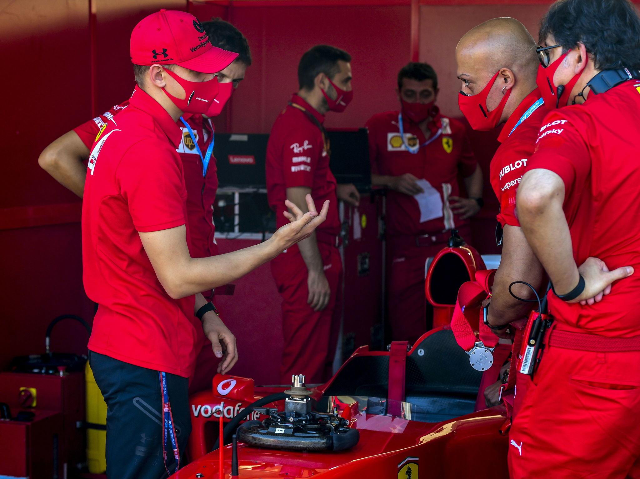 Mugello (Italy), 13/09/2020.- Former Ferrari driver Michael lt;HIT gt;Schumacher lt;/HIT gt;s son lt;HIT gt;Mick lt;/HIT gt; lt;HIT gt;Schumacher lt;/HIT gt; (L) talks with the Ferrari engineers and staff before the race ahead of the Formula One Grand Prix of Tuscany at the race track in Mugello, Italy 13 September 2020. (Fórmula Uno, Italia) EFE/EPA/Jennifer Lorenzini / Pool