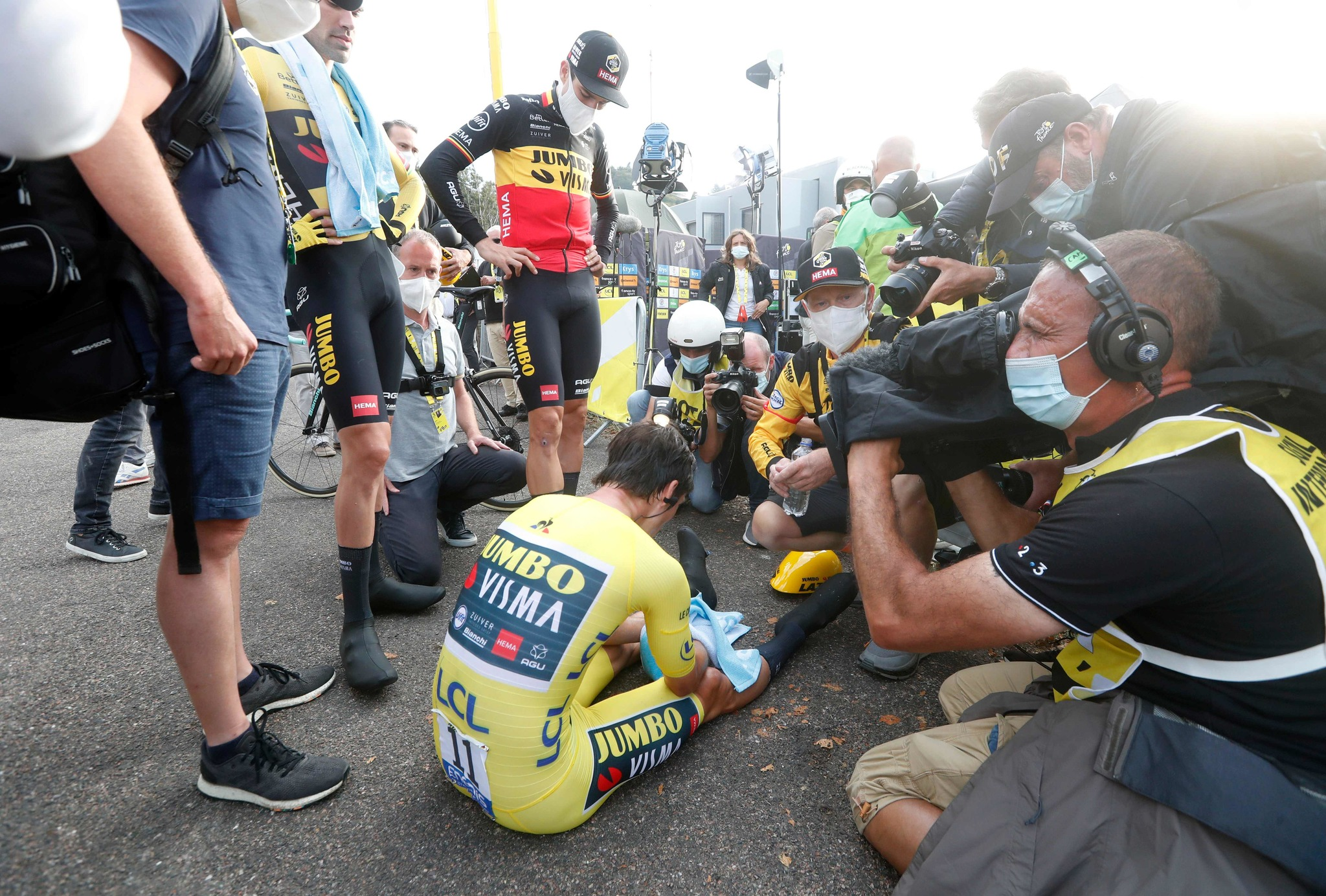 Team Jumbo rider Slovenias Primoz lt;HIT gt;Roglic lt;/HIT gt; wearing the overall leaders yellow jersey (down) rests next to Team Jumbo rider Netherlands Tom Dumoulin (2nd-L) and Team Jumbo rider Belgiums Wout van Aert (3rd-L) after crossing the finish line at the end of the 20th stage of the 107th edition of the Tour de France cycling race, a time trial of 36 km between Lure and La Planche des Belles Filles, on September 19, 2020. (Photo by Thibault Camus / POOL / AFP)