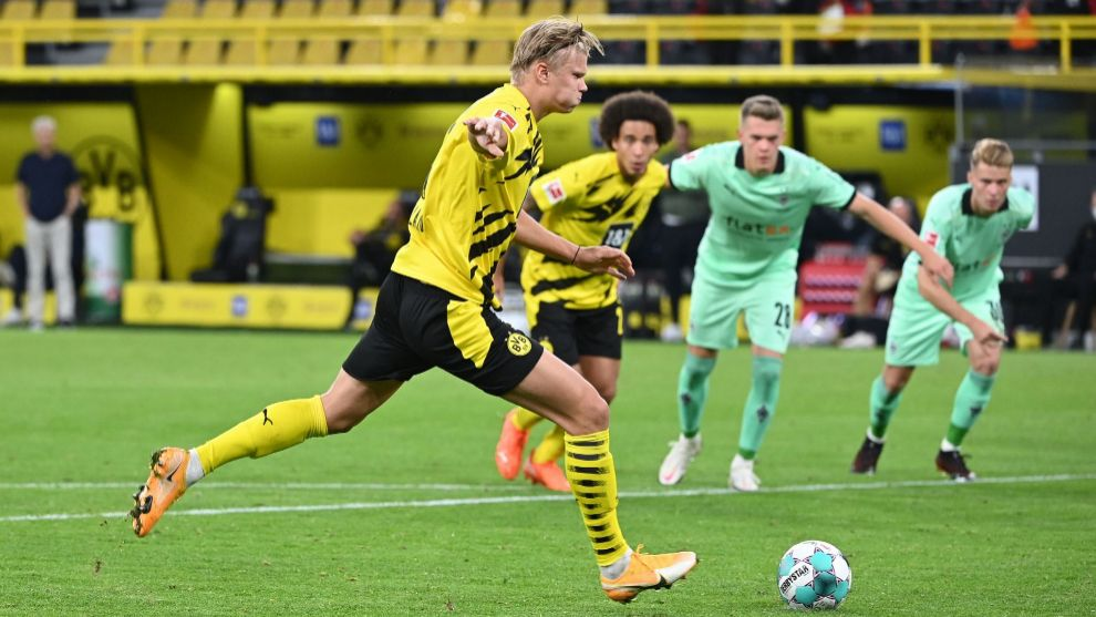 Dortmunds Norwegian forward Erling Braut lt;HIT gt;Haaland lt;/HIT gt; scores a penalty during the German first division Bundesliga football match Borussia Dortmund v Borussia Moenchengladbach in Dortmund, western Germany on September 19, 2020. (Photo by Ina Fassbender / AFP) / DFL REGULATIONS PROHIBIT ANY USE OF PHOTOGRAPHS AS IMAGE SEQUENCES AND/OR QUASI-VIDEO