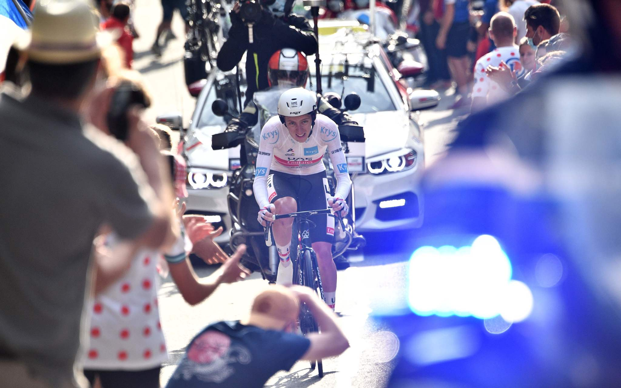 TOPSHOT - Team UAE Emirates rider Slovenias Tadej lt;HIT gt;Pogacar lt;/HIT gt; wearing the best youngs white jersey rides during the 20th stage of the 107th edition of the Tour de France cycling race, a time trial of 36 km between Lure and La Planche des Belles Filles, on September 19, 2020. (Photo by Anne-Christine POUJOULAT / AFP)