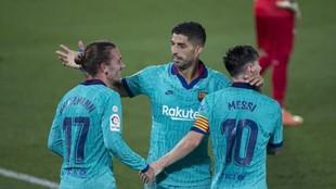 Suárez y Griezmann celebran un gol con el Barça.