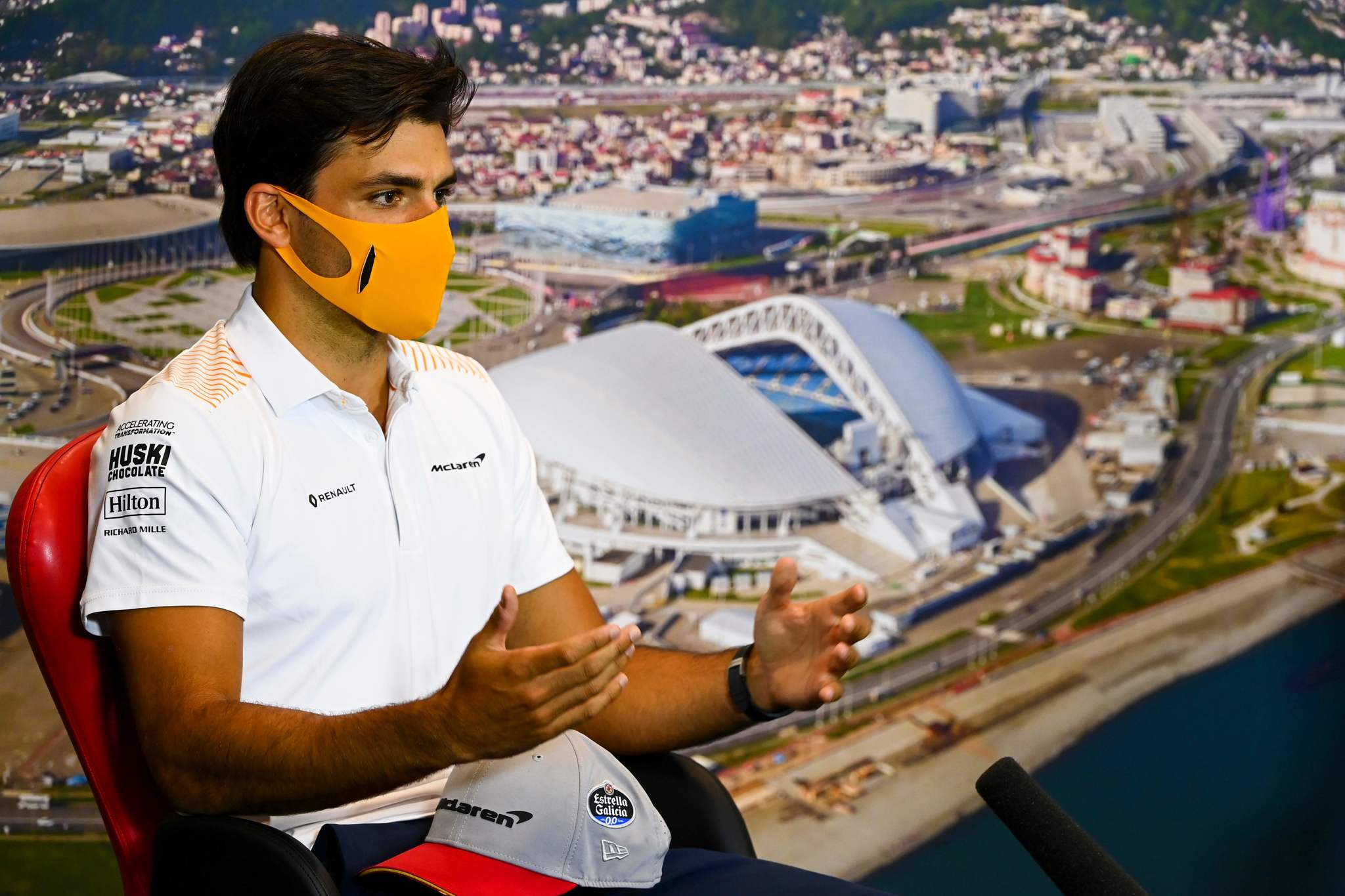 """This handout photo taken on September 24, 2020 by the International Automobile Federation (FIA) shows McLarens Spanish driver lt;HIT gt;Carlos lt;/HIT gt; lt;HIT gt;Sainz lt;/HIT gt; Jr addressing the drivers press conference for the Formula One Russian Grand Prix, at the Sochi Autodrom circuit in Sochi. (Photo by Mark Sutton / FIA / AFP) / RESTRICTED TO EDITORIAL USE - MANDATORY CREDIT """"AFP PHOTO / FIA / Mark SUTTON"""" - NO MARKETING - NO ADVERTISING CAMPAIGNS - DISTRIBUTED AS A SERVICE TO CLIENTS"""