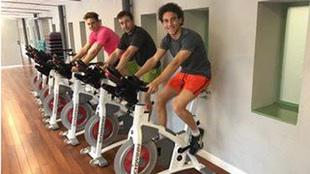 Marcos Llorente, Adolfo Madrid y Luis Milla entrenando.