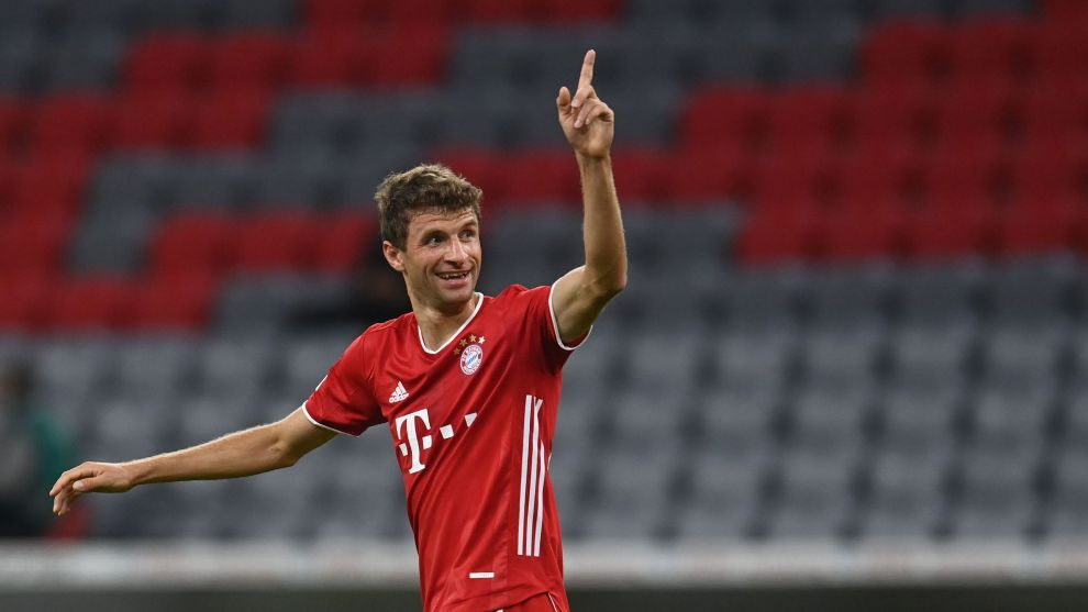 lt;HIT gt;Bayern lt;/HIT gt; Munichs German forward Thomas Mueller celebrates scoring 2:0 during the German Supercup football match FC lt;HIT gt;Bayern lt;/HIT gt; Munich v BVB Borussia Dortmund in Munich, Southern Germany, on September 30, 2020. (Photo by CHRISTOF STACHE / POOL / AFP) / DFL REGULATIONS PROHIBIT ANY USE OF PHOTOGRAPHS AS IMAGE SEQUENCES AND/OR QUASI-VIDEO