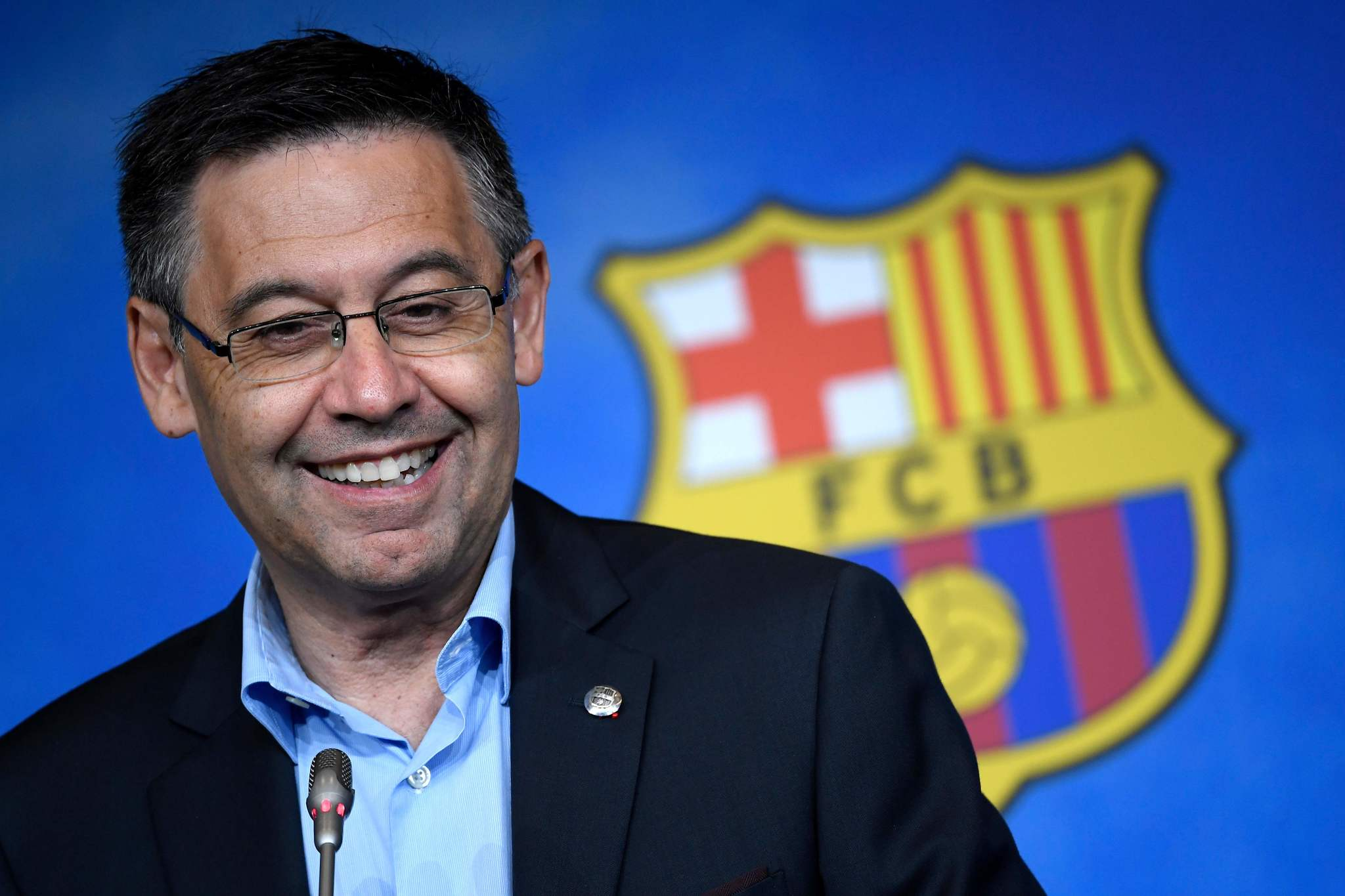 (FILES) In this file photo taken on July 05, 2019 Barcelonas president Josep Maria lt;HIT gt;Bartomeu lt;/HIT gt; smiles during a press conference at the Camp Nou stadium in Barcelona. - An unexpected winner in 2015 and Barcelonas bad guy in 2020, the clubs president Josep Maria lt;HIT gt;Bartomeu lt;/HIT gt; might feel some satisfaction after winning his showdown with Lionel lt;HIT gt;Messi lt;/HIT gt;. (Photo by LLUIS GENE / AFP)