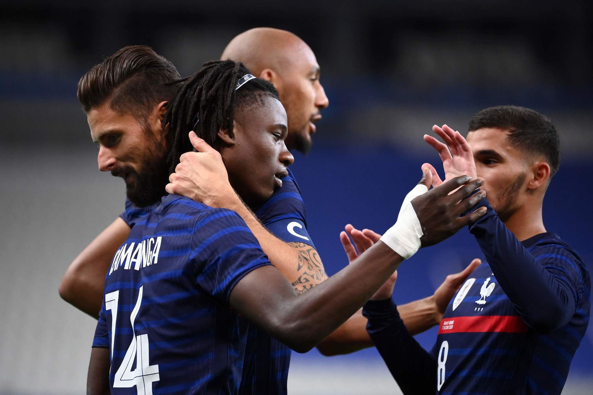Frances midfielder Eudardo lt;HIT gt;Camavinga lt;/HIT gt; (C) is congratulated by teammates after scoring a goal during the International friendly football match between France and Ukraine, on October 7, 2020 in Saint-Denis, outside Paris. (Photo by FRANCK FIFE / AFP)