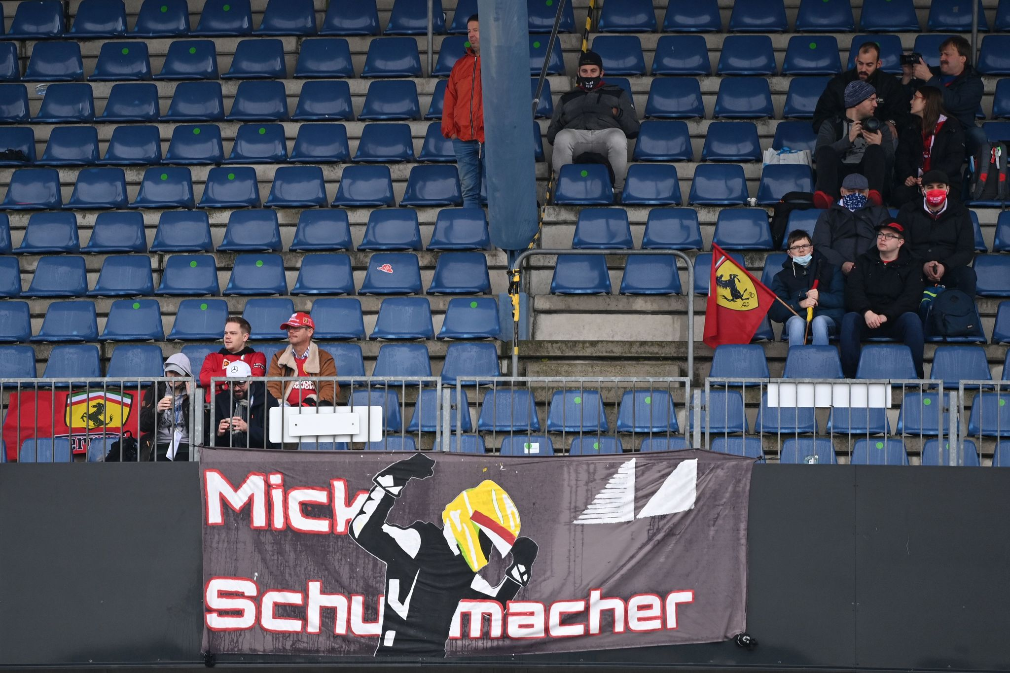 A banner for Alfa Romeos German driver lt;HIT gt;Mick lt;/HIT gt; lt;HIT gt;Schumacher lt;/HIT gt; hangs from the stands while spectators wait as the start of the first practice session is delayed at the Nuerburgring circuit in Nuerburg, western Germany, on October 9, 2020, ahead of the German Formula One Eifel Grand Prix. (Photo by Ina Fassbender / POOL / AFP)
