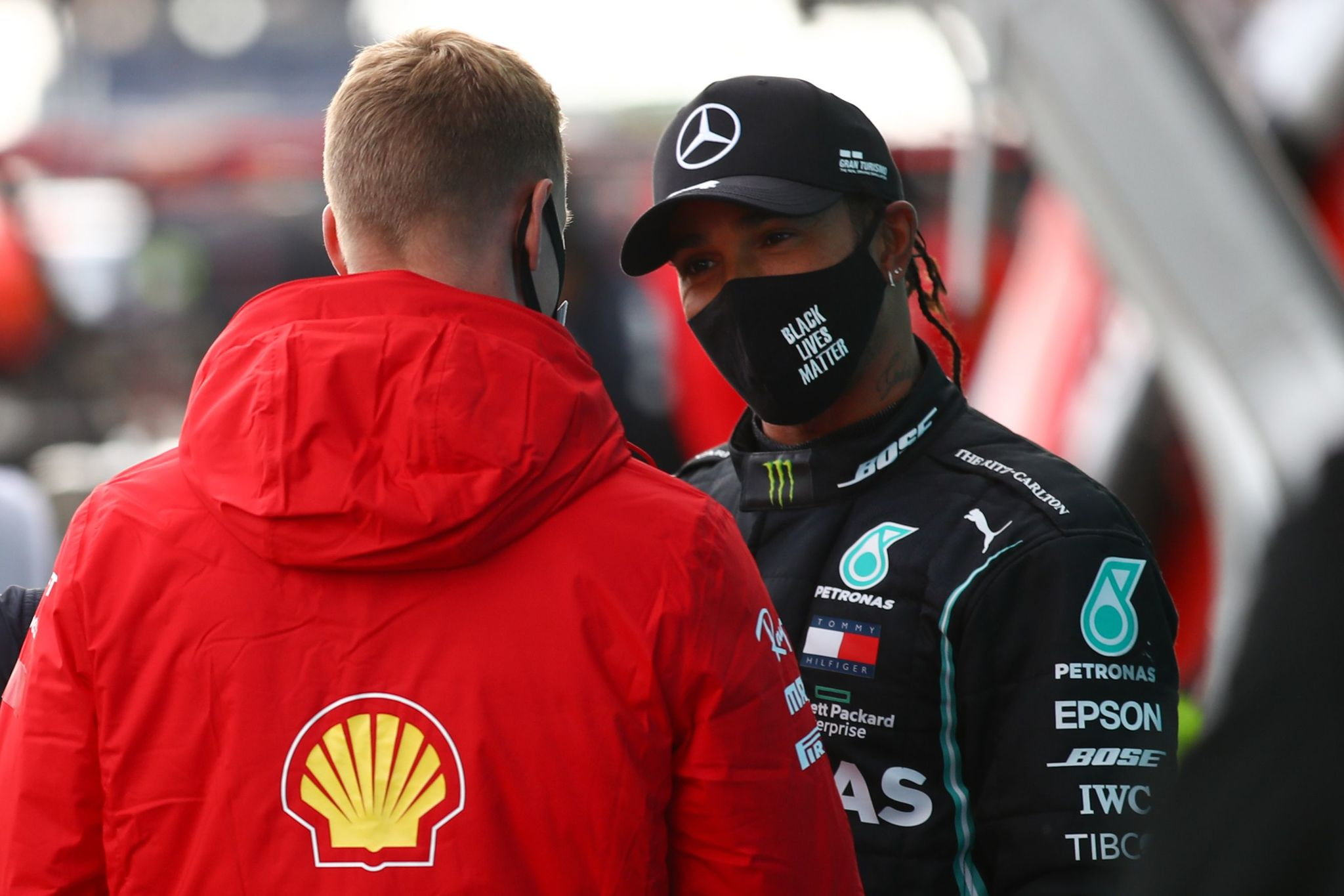 Alfa Romeos German driver Mick lt;HIT gt;Schumacher lt;/HIT gt; (L) talks to winner Mercedes British driver Lewis Hamilton after the German Formula One Eifel Grand Prix at the Nuerburgring circuit in Nuerburg, western Germany, on October 11, 2020. (Photo by Bryn Lennon / POOL / AFP)