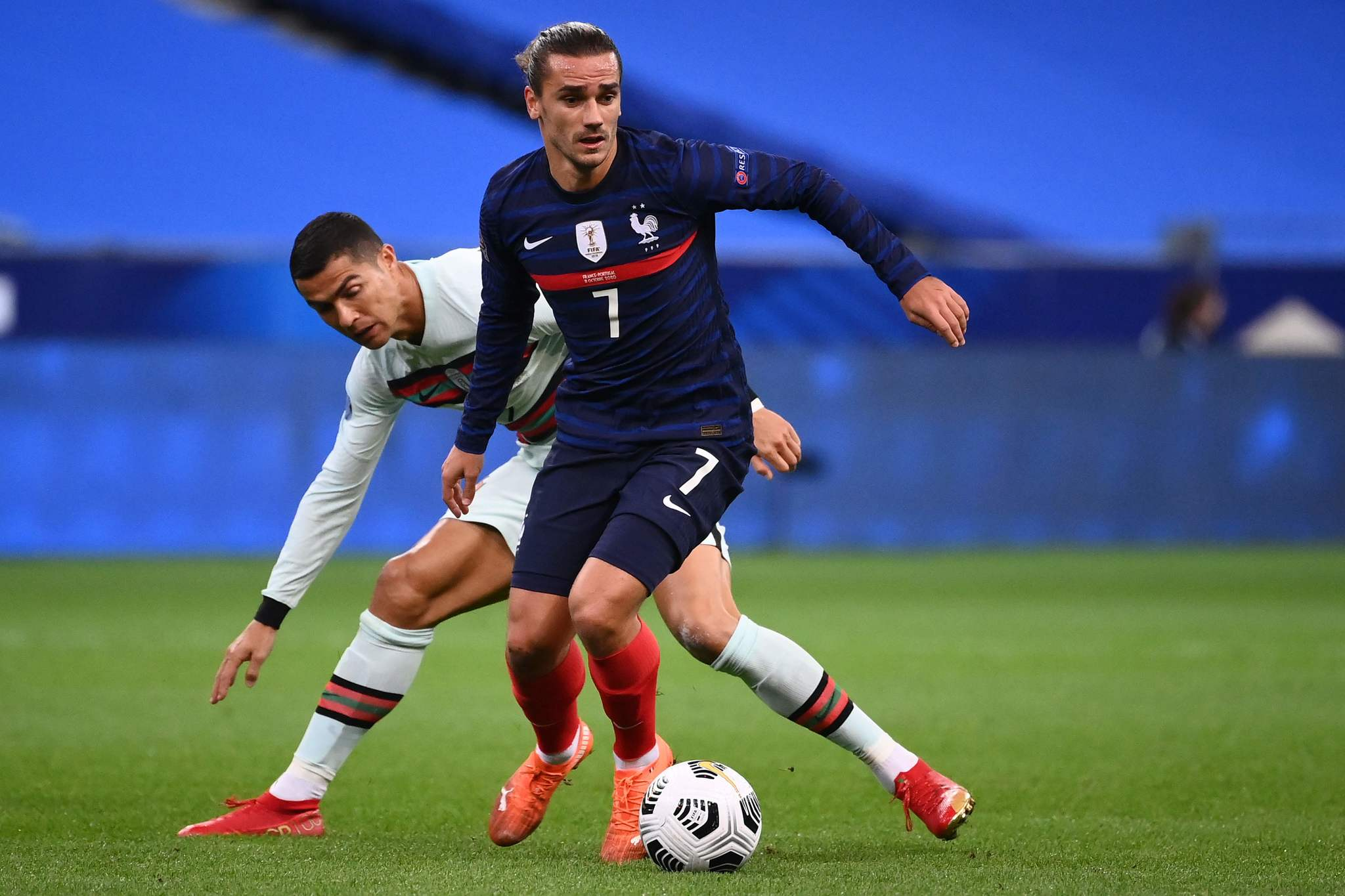 Frances forward Antoine lt;HIT gt;Griezmann lt;/HIT gt; (C) vies with Portugals forward Ronaldo during the Nations League football match between France and Portugal, on October 11, 2020 at the Stade de France in Saint-Denis, outside Paris. (Photo by FRANCK FIFE / AFP)