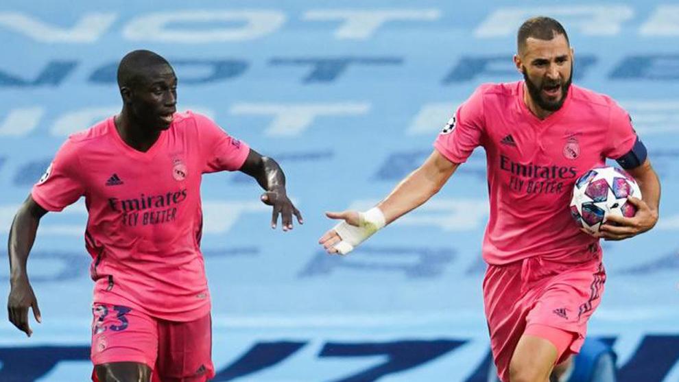 Mendy y Benzema celebran el gol al City